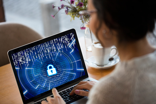 data security tools, woman sitting with a laptop showing a locked screen