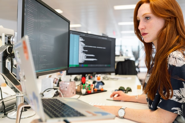 IT Support Provider; woman working on a computer